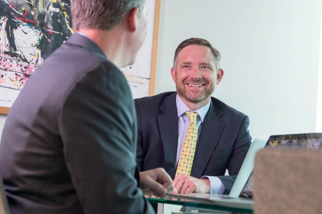 Commercial Broker, Phil Kubat, Smiles with Team Member, Zac Cihak - Share a Referral Through our Refer a Client Form