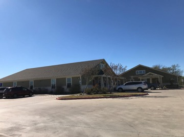Photo of buildings and property for sale at 4409 John Stockbauer Drive in Victoria, TX.